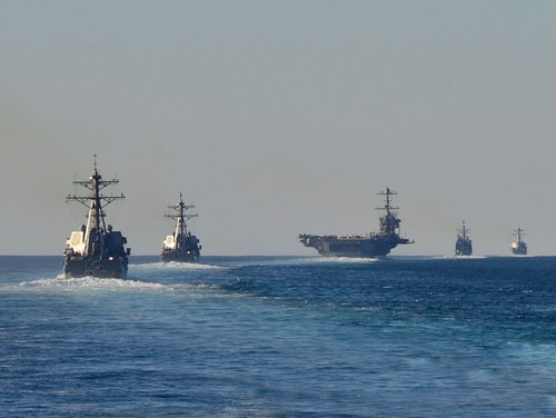 Ships from the Harry S. Truman Carrier Strike Group conduct a strait transit exercise. The Navy will grow rapidly over the next five years, according to Navy officials. (MC3 Michael Chen/Navy)