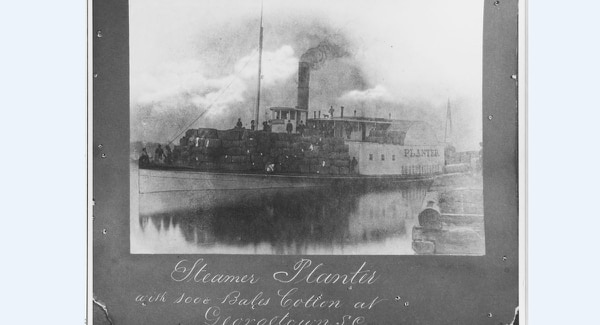 The steamship Planter (1860-1876), loaded here with 1,000 bales of cotton, at Georgetown, South Carolina, probably in 1860-61 or 1866-76. She was a side-wheel steamer, built at Charleston, South Carolina, in 1860. (Courtesy of E.D. Sloan, Jr., 1971, U.S. Naval History and Heritage Command)