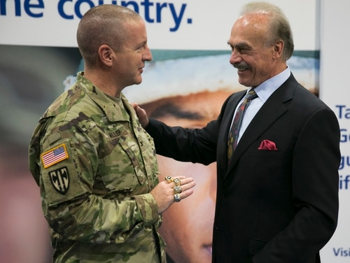 Former Pittsburgh Steeler and Vietnam veteran Rocky Bleier places his four Super Bowl rings on Col. Duane Miller during an autograph session at the annual Association of the US Army conference at Walter E. Washington Convention Center in 2015. (Mike Morones/staff)