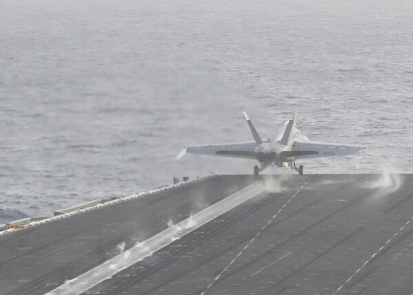An F/A-18E Super Hornet from the Fist of the Fleet, Strike Fighter Squadron 25, launches Saturday from the aircraft carrier Abraham Lincoln. Lincoln was sailing the Arabian Sea. (Mass Communication Specialist 3rd Class Dan Snow/Navy)