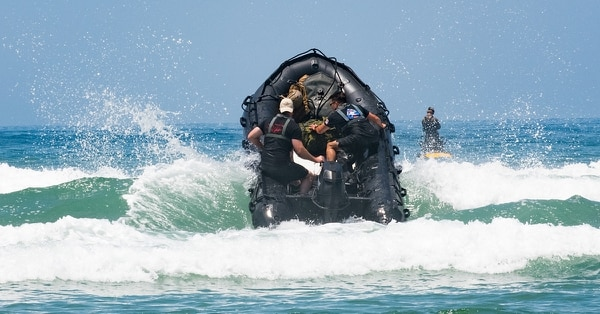 Members of the U.S. Marine Corps 1st Recon battle the surf during amphibious landing training on rigid-hull inflatable boats at Blue Beach training area during the biennial Rim of the Pacific (RIMPAC) Exercise, Marine Corps Base Camp Pendleton, July 8. (Ordinary Seaman Justin Spinello/Canadian Armed Forces)