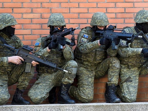 In this photo taken March 22, 2018, member of Kosovo Security Force train during hostage rescue exercise inside the barracks in the southern part of the ethnically divided town of Mitrovica. In a vote set for Friday, Dec. 14, 2018, Kosovo's 120-seat parliament is expected to approve draft legislation to expand the 4,000-strong paramilitary force into a lightly armed army. (Visar Kryeziu/AP)