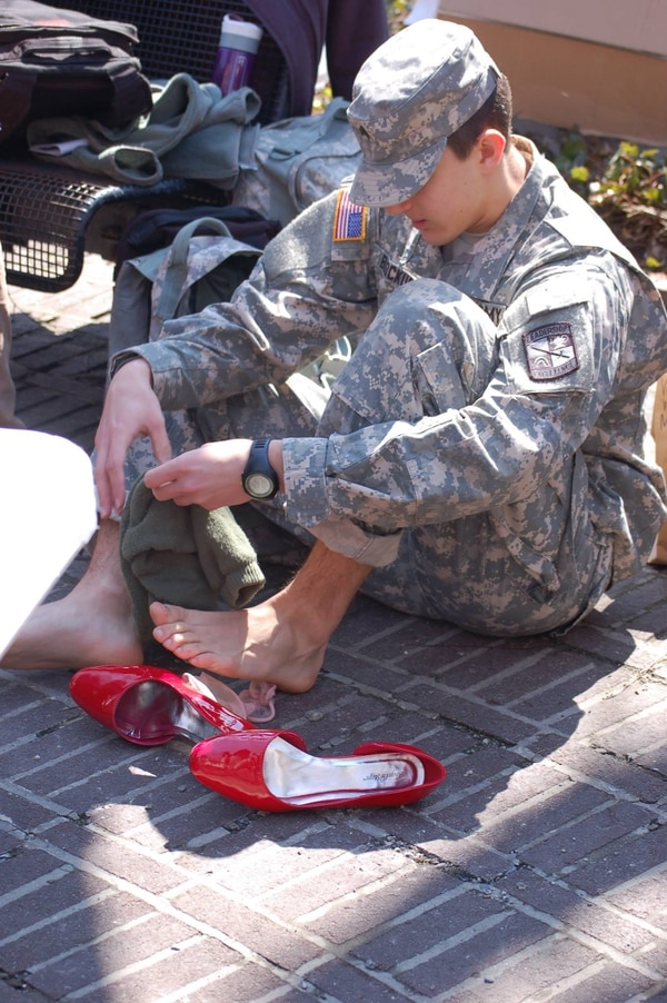 Cadets and cadre put on their favorite pair of high heels and marched in Temple's Walk a Mile in Her Shoes event to raise awareness of sexual assault against women. #TUWAM15 Temple University ROTC