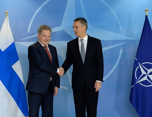 NATO Secretary General Jens Stoltenberg shakes hands with Finnish President Sauli Niinisto before their meeting at the NATO headquarters in Brussels on Nov. 9, 2016. Russia's has warned Finland about joining the alliance. (Thierry Charlier/AFP via Getty Images)
