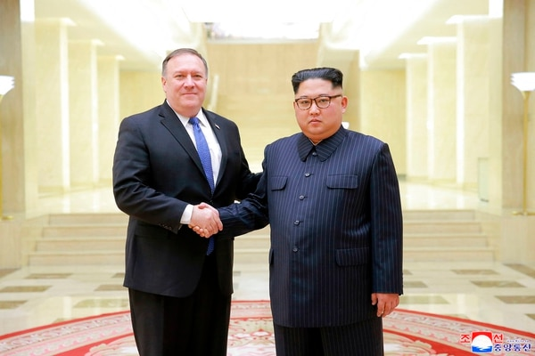 In this Wednesday, May 9, 2018, photo provided on Thursday, May 10, 2018, by the North Korean government, U.S. Secretary of State Mike Pompeo, left, poses with North Korean leader Kim Jong Un for a photo during a meeting at the Workers' Party of Korea headquarters in Pyongyang, North Korea. (Korean Central News Agency/Korea News Service via AP)