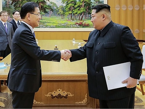 In this handout image provided by the South Korean Presidential Blue House, Chung Eui-Yong, head of the presidential National Security Office shakes hands with North Korean leader Kim Jong-Un during their meeting on March 5, 2018, in Pyongyang, North Korea. (Getty Images)