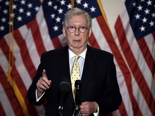 US Senate Majority Leader Mitch McConnell speaks to the press after a Republican policy lunch on Capitol Hill in Washington, DC on July 21, 2020. (Photo by Olivier DOULIERY / AFP) (Photo by OLIVIER DOULIERY/AFP via Getty Images)