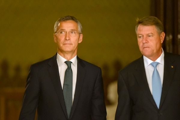NATO Secretary General Jens Stoltenberg, left, arrives for a press conference with Romania's President, Klaus Iohannis during a welcoming ceremony at the Cotroceni presidential palace in Bucharest, Romania, Monday, Oct. 9, 2017. (Andreea Alexandru/AP)