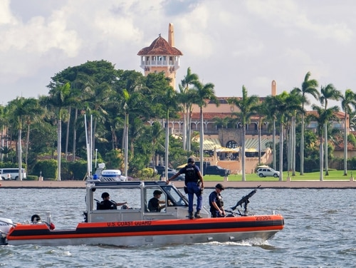 A U.S. Coast Guard patrol boat passes President Donald Trump's Mar-a-Lago estate in Palm Beach, Fla., on Nov. 22, 2018. House Democrats are opening an investigation into the influence of three club members on Veterans Affairs policies, despite no official roles with the government. (J. David Ake/AP)