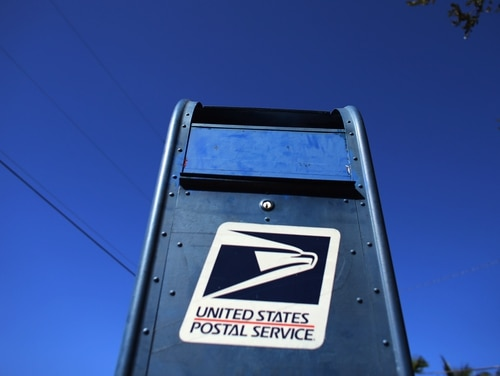 The U.S. Postal Service reported another quarter of financial losses, despite package volume increases, Aug. 7. (Joe Raedle/Getty Images)