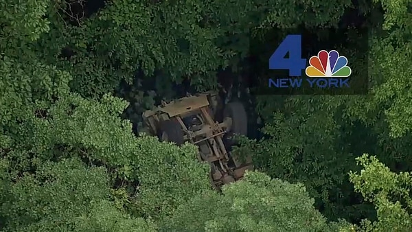 In this photo taken from video provided by NBC New York, a light medium tactical vehicle sits overturned near the Camp Natural Bridge summer military training camp off Route 293, Thursday, June 6, 2019 in Cornwall, N.Y. (NBC New York via AP)