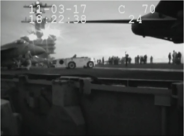 An image from the command investigation shows the second a jet at right's exhaust struck a chief boatswain's mate (handling). The chief can be seen at left. He fell into the path of the jet at left and was run over. (Navy)