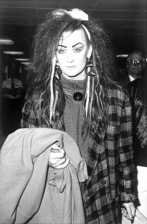 At the height of his fame, Boy George arrives at Heathrow airport in London in 1984. An Air Force colonel was arrested last week after trying to rush the stage as George and Culture Club performed. (AP Photo)