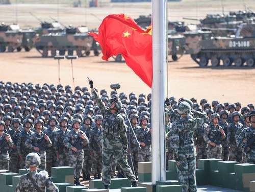 The Chinese flag is raised during a military parade at the Zhurihe training base in China's northern Inner Mongolia region on July 30, 2017. (STR/AFP/Getty Images)