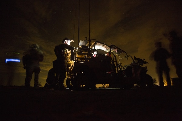 Marines with Special Operations Command process intelligence and set up a visual telecommunication feed after a simulated direct-action night raid, Oct. 20, 2015. (Cpl. Steven Fox/ Marine Corps)