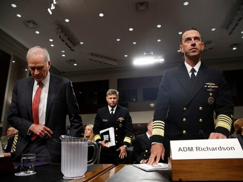 Secretary of the Navy Richard Spencer, left, and Chief of Naval Operations Adm. John Richardson, right, take their seats for a Senate Armed Services Committee hearing on