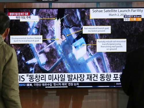 In this March 6, 2019, file photo, people watch a TV screen showing an image of the Sohae Satellite Launching Station in Tongchang-ri, North Korea, during a news program at the Seoul Railway Station in Seoul, South Korea. (Ahn Young-joon/AP)