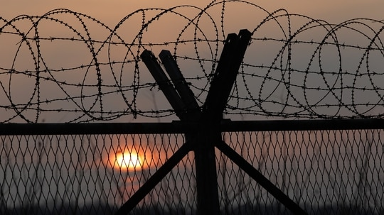 A barbed wire fence at a military check point near the demilitarized zone (DMZ) separates South and North Korea in Paju, South Korea. President Donald Trump plans to visit South Korea soon but doesn't intend to go to the DMZ, the White House said. (Photo by Chung Sung-Jun/Getty Images)