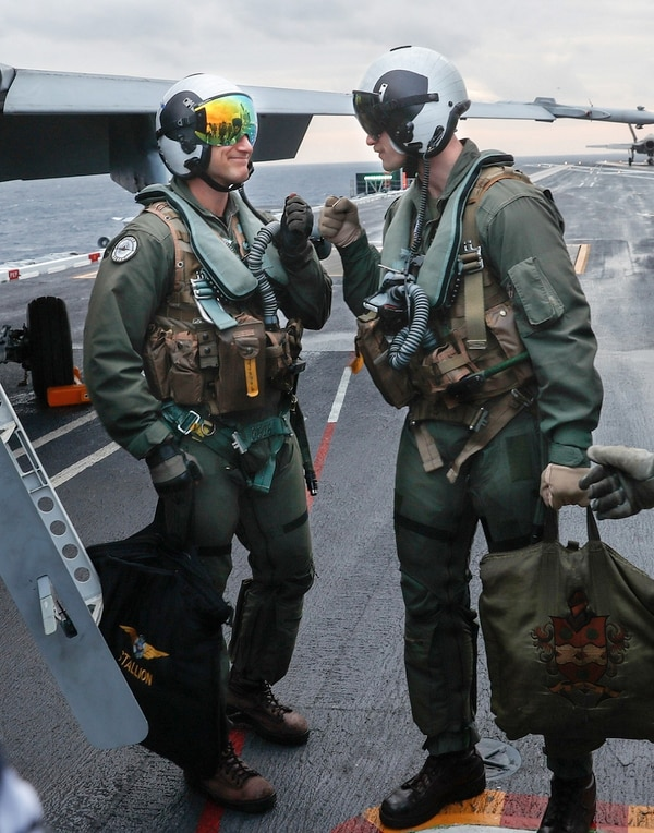 U.S. Marine Corps. Capt. Michael Humiston, right, congratulates Finnish Air Force Capt. Juha Jarvinen after his successful arrested landing. (MC1 Brian M. Wilbur/Navy)
