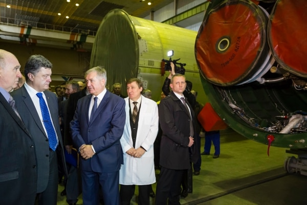 FILE In this file photo taken on Tuesday, Oct. 21, 2014, Ukrainian President Petro Poroshenko, second from left, visits the Yuzhmash aerospace enterprise in Dnipro, Ukraine, on Oct. 21, 2014. (Mikhail Palinchak/AP)