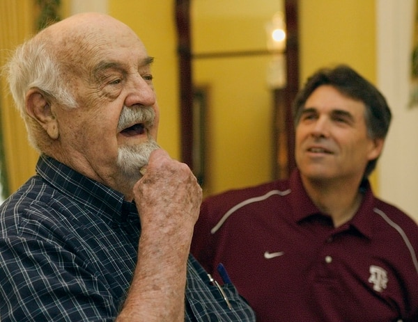 John Keith Wells, left, responds to a question about his goatee asked by Texas Gov. Rick Perry, right, Sunday, June 11, 2006, in Austin, Texas. Perry hosted a brunch for Wells, of Abilene, Texas, who served in World War II as a Marine Corps 1st Lt. It was under his leadership in the battle of Iwo Jima Island that his 3rd Platoon, Easy Company, 2nd Battalion, 28th Marines, 5th Marine Division became the most decorated platoon to fight in a single engagement in the history of the USMC to date. (AP Photo/Harry Cabluck)
