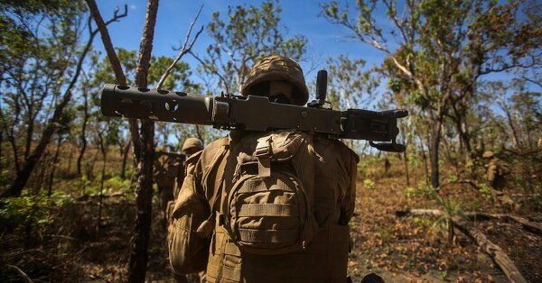 Marines with Weapons Company, 3rd Battalion, 4th Marine Regiment, 1st Marine Division, Marine Rotational Force-Darwin, patrol to their support by fire position during Exercise Koolendong 2017, July 17, 2017. (Sgt. Emmanuel Ramos/Marine Corps)