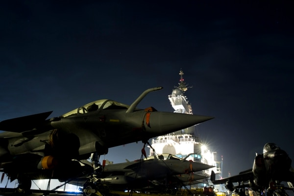 A picture taken on December 31, 2015 in Manama shows French army Rafale figther jets parked on the flight deck of France's Charles de Gaulle aircraft carrier. / AFP / POOL / KENZO TRIBOUILLARD (Photo credit should read KENZO TRIBOUILLARD/AFP/Getty Images)