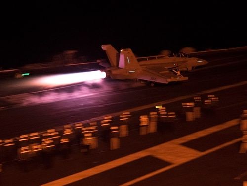 "151228-N-CC806-145 ARABIAN GULF (Dec. 28, 2015) An EA-18G Growler assigned to the ""Patriots"" of Electronic Attack Squadron (VAQ) 140 launches from the flight deck of the aircraft carrier USS Harry S. Truman (CVN 75). The Harry S. Truman Carrier Strike Group is deployed in support of Operation Inherent Resolve, maritime security operations, and theater security cooperation efforts in the U.S. 5th Fleet area of responsibility. (U.S. Navy photo by Mass Communication Specialist 2nd Class B. B. Petkovski/Released)"