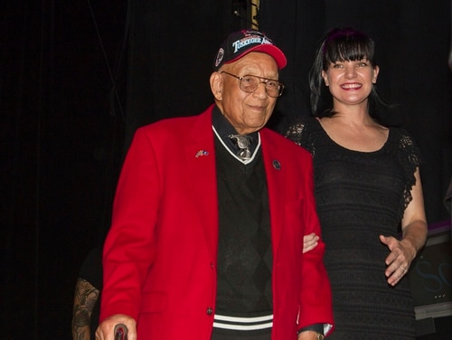 In this Sept. 11, 2013, file photo, actress Pauley Perrette, right, and Lt. Col. Bob Friend, a Tuskegee Airman, stand onstage during the 2nd Annual Heroes Helping Heroes Benefit Concert at The House of Blues in Los Angeles. World War II pilot Friend, one of the last original members of the famed all-black Tuskegee Airmen, has died at the age of 99. (Paul A. Hebert/Invision/AP)