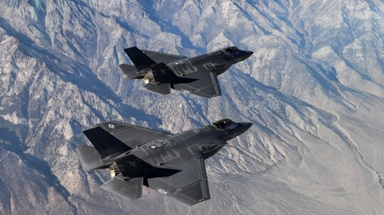 Two F-35C Lightning II aircraft attached to the Argonauts of Strike Fighter Squadron (VFA) 147, stationed at Naval Air Station Lemoore, fly in formation for a photo exercise over the California desert on Nov. 16, 2018. (Chief Mass Communication Specialist Shannon E. Renfroe/Navy)