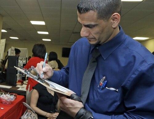 Army veteran Fareed Farraj fills out a job application at an annual Veterans Career and Resource Fair in Miami. (Alan Diaz/AP)