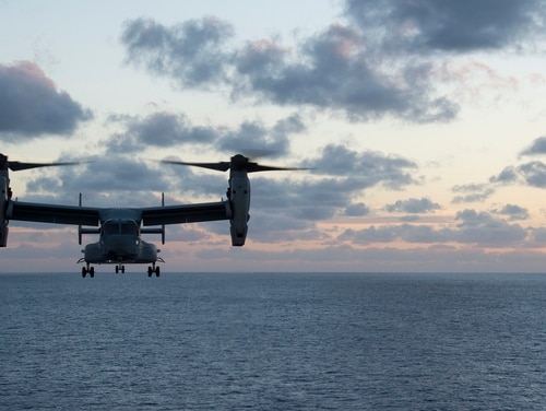 "An MV-22B Osprey, assigned to the ""Dragons"" of Marine Medium Tiltrotor Squadron (VMM) 265 (Reinforced), lands on the flight deck of the amphibious assault ship USS Bonhomme Richard (LHD 6) as part of an embassy reinforcement exercise. (Mass Communication Specialist Seaman Cosmo Walrath/Navy)"