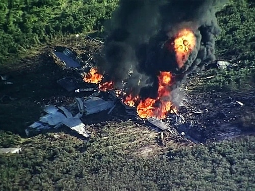 In this Monday, July 10, 2017, frame from video, smoke and flames rise from a military plane that crashed in a farm field, in Itta Bena, Miss., killing several. (WLBT-TV via AP)