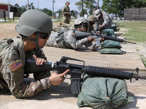 Army Reserve Pvt. Anna Tran prepares to fire at a Fort Benning rifle range on May 18. Competing drafts of the annual defense authorization bill moving through Congress contain a host of issues till to be worked out, including several personnel policy fights. (Sgt. 1st Class Gary A. Witte/Army)