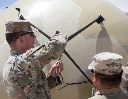 Soldiers from the 1st Armored Division's G6 staff section construct a Transportable Tactical Command Communications (T2C2) system during a training event May 2 at the Mission Training Center (MTC) on Fort Bliss, Texas. T2C2 is an expeditionary inflatable satellite antenna system providing military commanders with increased operational flexibility and speed during operations in austere environments. (U.S. Army photo by Spc. Matthew J. Marcellus)