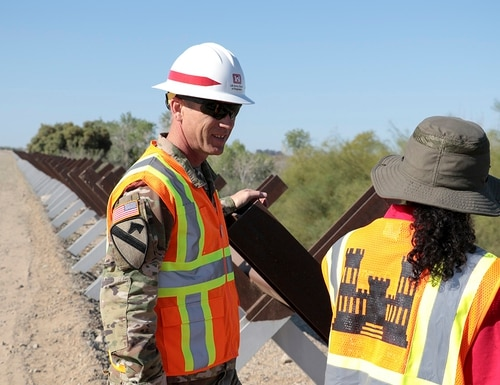 Engineers from the U.S. Army Corps of Engineers discuss replacing existing vehicle barriers with pedestrian border wall fencing near Yuma, Ariz., on March 28, 2019. (Army Corps of Engineers)