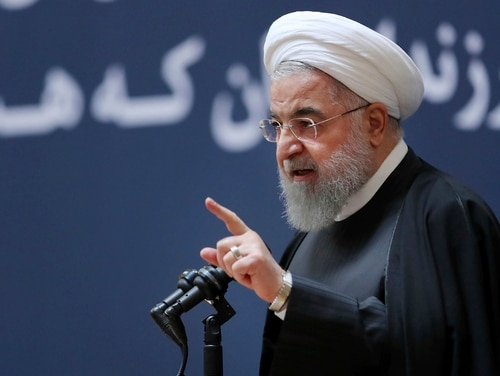 President Hassan Rouhani speaks at a ceremony to mark the second anniversary of the death of former Iranian President Akbar Hashemi Rafsanjani, in Tehran, Iran, Thursday, Jan. 10, 2019. Rouhani says the country will soon send two new satellites into orbit using Iran-made rockets. (Iranian Presidency Office via AP)