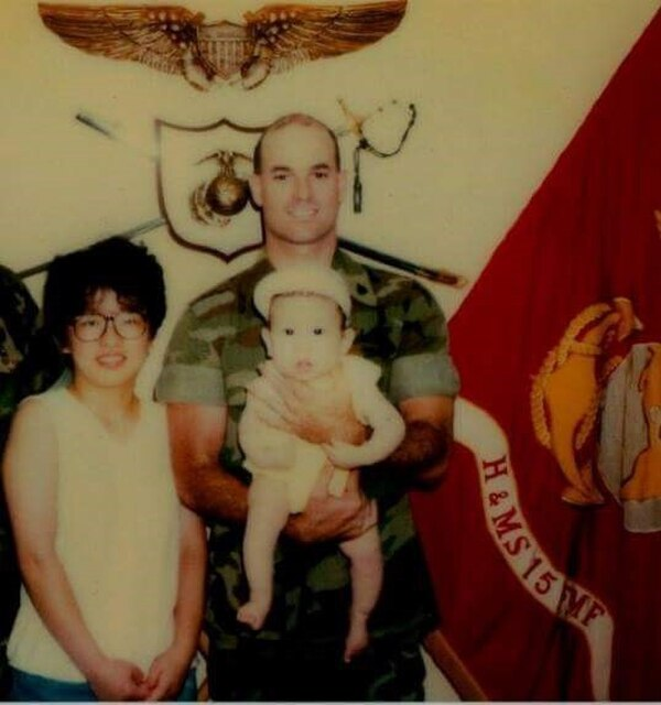 Marine Brian Heafy, standing with his wife, holds a young Matt for a picture. (Photo courtesy of Matt Heafy)