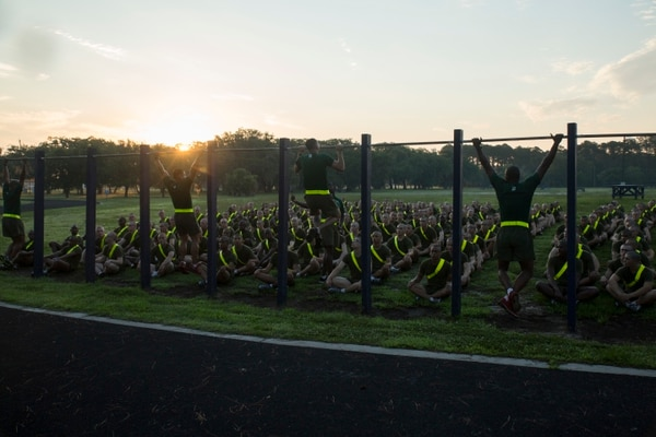 Drill instructors with Support Battalion demonstrate proper pullups to new recruits of India Company, 3rd Recruit Training Battalion, June 10, 2016, on Parris Island, S.C. The minimum physical requirements for male recruits to begin training are 44 crunches in two minutes, three pullups and a 1.5-mile run in 13 minutes, 30 seconds. India Company is scheduled to graduate Sept. 2, 2016. Parris Island has been the site of Marine Corps recruit training since Nov. 1, 1915. Today, approximately 19,000 recruits come to Parris Island annually for the chance to become United States Marines by enduring 12 weeks of rigorous, transformative training. Parris Island is home to entry-level enlisted training for approximately 49 percent of males and 100 percent of females in the Marine Corps. (Photo by Cpl. Vanessa Austin)