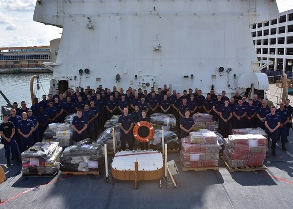 The crew of the Coast Guard Cutter James takes a moment for a group photo before offloading approximately 6 tons of cocaine worth an estimated $180 million in Port Everglades, Fla., on May 10, 2018. (Petty Officer 2nd Class Jonathan Lally/Coast Guard)