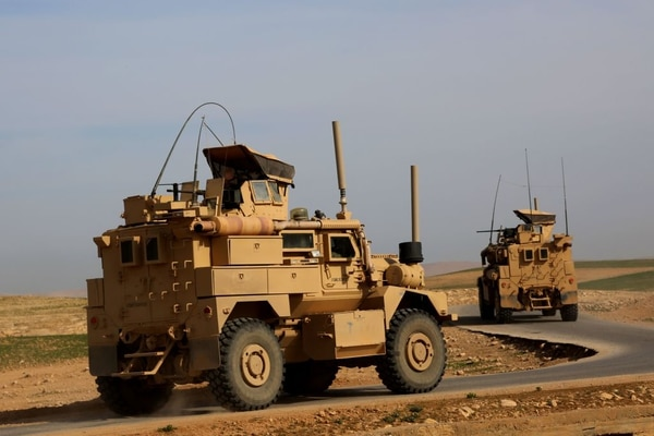 US-made armoured vehicles bearing markings of the US Marine Corps are seen on a road north of Raqa in northern Syria on March 27, 2017. US-backed forces battled the Islamic State group around a key Syrian town, after the capture of an airbase brought them closer to besieging the jihadists in their stronghold Raqa.Operations are currently focused on the strategically important town of Tabqa on the Euphrates River, and the adjacent dam and military airport. / AFP PHOTO / DELIL SOULEIMAN (Photo credit should read DELIL SOULEIMAN/AFP/Getty Images)
