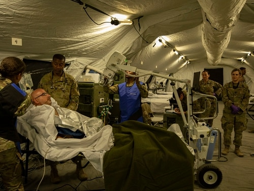 Soldiers assigned to the 531st Hospital Center prepare a simulated patient for x-rays in their intensive care unit on Oct. 26, 2019. (Army)