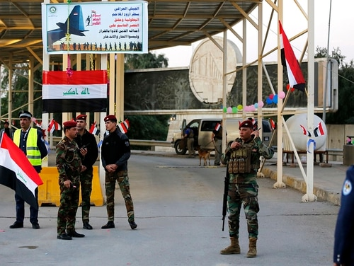 In this Dec. 10, 2018, file photo, Iraqi security forces stand guard as they check motorists entering the Green Zone, in Baghdad, Iraq. (Karim Kadim/AP)