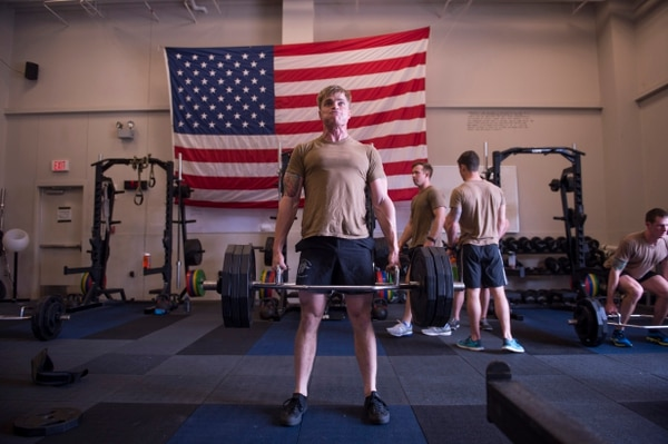 Special operations airmen perform compound lifts and other exercises with free weights. (24th Special Operations Wing)