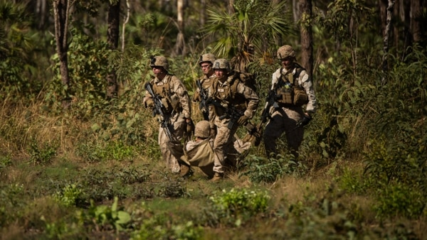 U.S. Marines move a simulated casualty onto a landing zone outside of Robertson Barracks, Northern Territory, Australia, May 20, 2016.