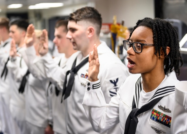 Hospital Corpsmen recite the Corpsman Pledge on board the amphibious assault ship Boxer in the Bay of Bengal during a June 19 ceremony celebrating the 121st birthday of the rating. (Mass Communication Specialist 3rd Class Alexander C. Kubitza/Navy)