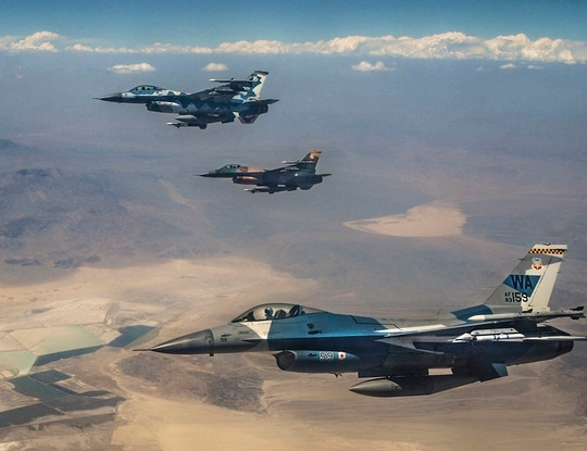 Three F-16 Fighting Falcon fighter jets fly over the Nevada Test and Training Range in July 2018, during Red Flag 18-3. (Airman Bailee Darbasie/Air Force)