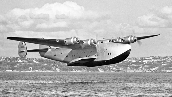The famous Boeing 314 Clipper flying low over a body of water. (Library of Congress)