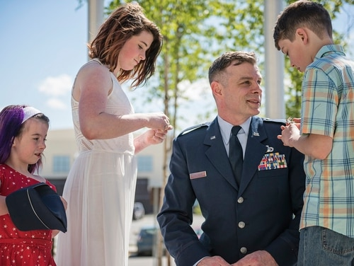 Capt. John Callahan, public affairs officer, 176th Wing, Alaska Air National Guard, was promoted to the rank of major at a ceremony on Joint Base Elmendorf-Richardson, Alaska, May 15. (Staff Sgt. Edward Eagerton/Air Force)