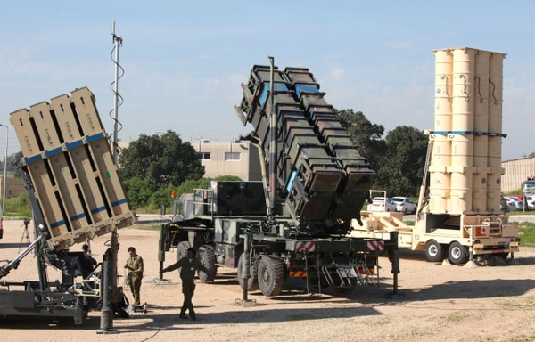 Israeli soldiers walk near an Israeli Irone Dome defence system (L), a surface-to-air missile (SAM) system, the MIM-104 Patriot (C), and an anti-ballistic missile the Arrow 3 (R) during Juniper Cobra's joint exercise press briefing at Hatzor Israeli Air Force Base in central Israel, on February 25, 2016. Juniper Cobra, is held every two years where Israel and the United States train their militaries together to prepare against possible ballistic missile attacks, as well as allowing the armies to learn to better work together. / AFP / GIL COHEN-MAGEN (Photo credit should read GIL COHEN-MAGEN/AFP/Getty Images)